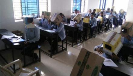 Чтобы предотвратить списывание на экзамене, студентов заставили надеть картонные коробки