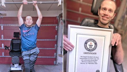Провисев на турнике 16 минут, мужчина стал мировым рекордсменом